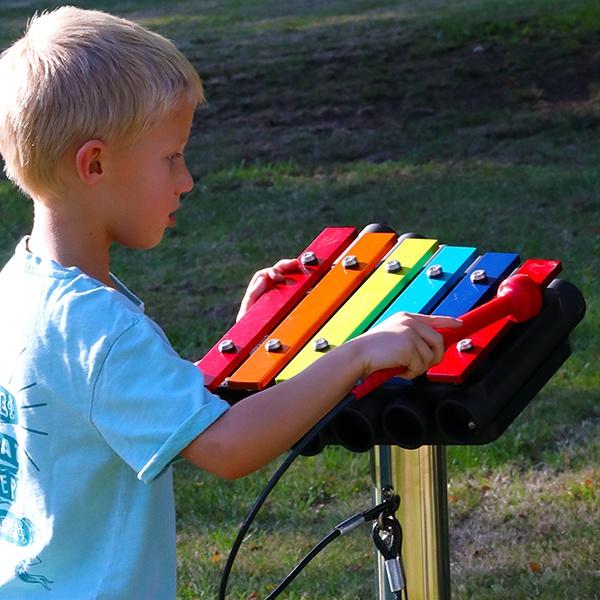 Kid playing the Xylophones